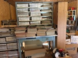 Yes there's a fabulous industrial desk under the piles of magazines