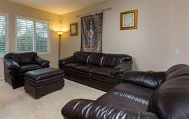 leather sofa and chairs. Rug and art on the walls are not for sale!