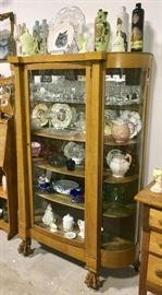SUPER NICE CURVED WAVY ORIGINAL GLASS OAK WOOD CHINA OR DISPLAY CABINET WITH LARGE WOOD CLAW FEET.