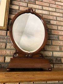 Antique table mirror with drawer that slides out to each side to hold brush and comb. Beautiful piece