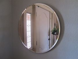 Pink glass beveled mirror, deco style; excellent condition.