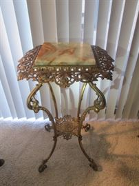 Mom's antique brass & marble stand; filigree edges; marble very good no chips; heavy & stands straight; measures 4 ft. tall.