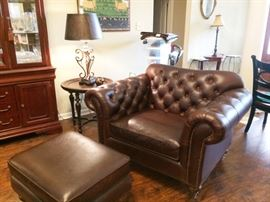 Leather chair with ottoman     accent tables   lamps   silk art work     china cabinet   mirror