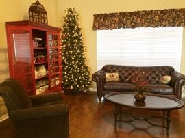 Christmas tree   oval coffee table    leather sofa     swirling chair there is a pair of these chairs like new