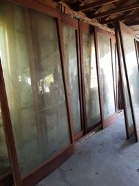 Set of EIGHT large vintage architectural windows...mahogany frames, 6 of them with CURVED GLASS!