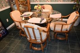 "Rattan and 48"" Round Glass Table with 4 Swivel Base Chairs"