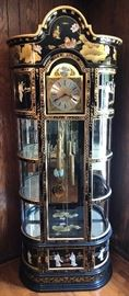 Gorgeous black lacquer - working - grandfather clock with hand painting and mother of pearl artwork, inlay - and display cases on either side of clockworks and cabinets above and below - plus lighting for display cases.
