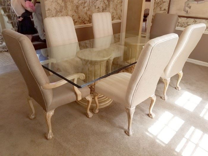 """A must see glass dining room table with fabulous pedestal base! Purchased from LBrandys and (6) upholstered chairs! Table measures 4' x 8' and the pedestals are 18-1/2"""" diameter. Table - $200 and chairs - $50 each."""