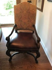 one of four dining room chairs:  quite large, leather and upholstery fabric