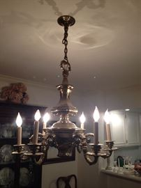 Large, solid brass light fixture. Currently in crate (already removed)