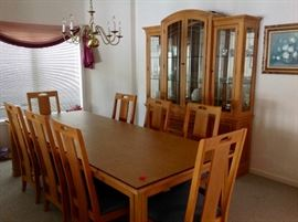 Dining Table with 8 Chairs & Table Pads, and a matching China Cabinet