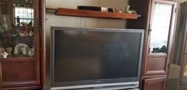 One of the flat screens and entertainment unit