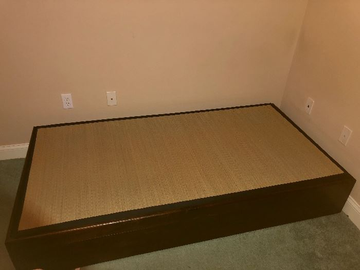 Authentic Japanese bed with rush mat on top.  Storage inside has mattress.