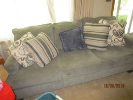 Sofa with matching love seat and coordinating pillows