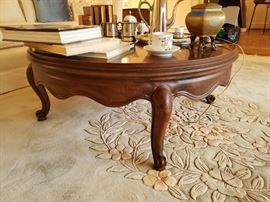 Round French style coffee table with scalloped skirt and cabriole legs