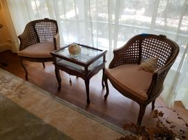 Two caned back chairs and display cabinet