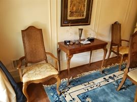 French style arm chairs with caned backs with four more side chairs, matching dining table