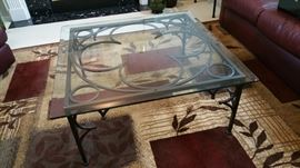 accent cocktail table - heavy decorative iron base with thick glass top