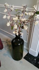 very large thick glass jug - jar with faux star magnolias - nice!
