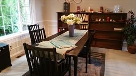 dining room  - contemporarty black dining table with large leaf and 5 chairs.... oversize large fir bookcase, real wood, hand made