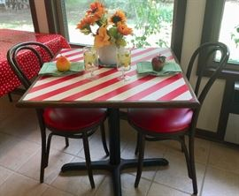 Red and white striped table with two matching chairs. TGIF in your own home with this restaurant table and chairs!