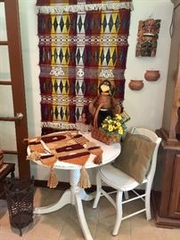 Antique white painted table with one chair ready to fill a special nook in your home