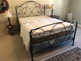 Black wrought iron Queen size bed with foam mattress