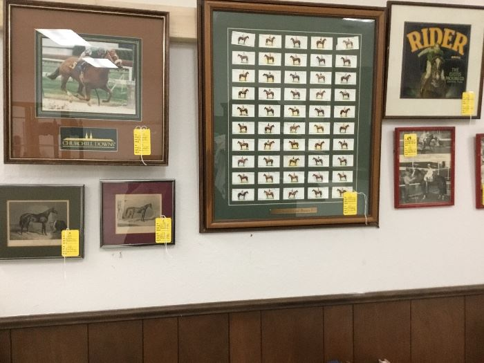 Large collection of racing memorabilia including pictures of famous racehorses.