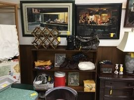 Wooden shelf filled with collectibles, pictures