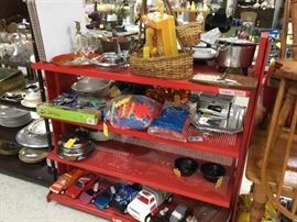 Another picture of items on red shelf