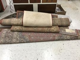 Various rugs in several sizes from an estate