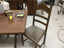 This is the second oak table with 6 chairs