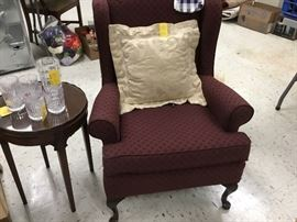 Red cloth wingback chair with curved legs