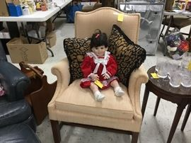 Beige chair  - and that's a very alive looking Doll