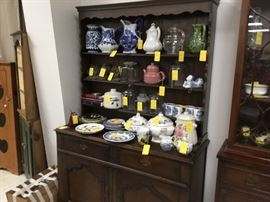 Buffet with open shelves, more stoneware