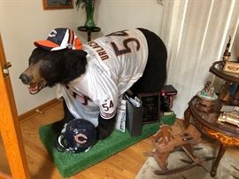 One-of-a-kind!  This is the ultimate Bears' fan sports item!  This is the only one in  existence, as it was a raffle prize at a local charity. American full size  black bear on all fours , with  Brian Urlacher sign jersey number 54 ; a total  of eight Chicago Bears' signatures, including Dave Duerson .  (Signed helmet, hat, and jersey are extra)