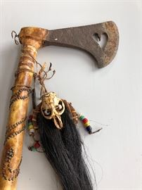 Indian hand forged tomahawk with leather wrap and horsehair drop 20 inches  long bleeding heart cut out that has brain 10 inch leather wrapped handle  the head is approximately seven and half inches long by 4 1/2 inches wide  outstanding presentation