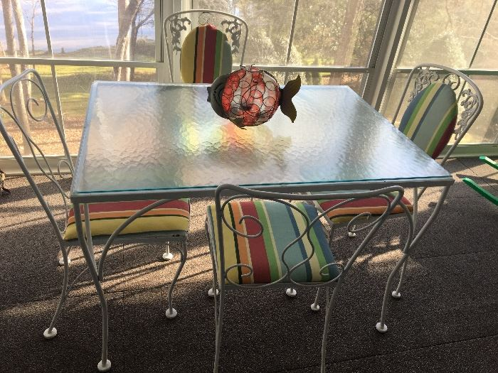IRON GLASS TOP TABLE AND CHAIRS.