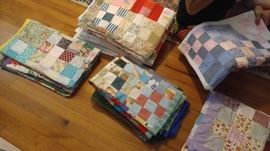 Many hand made baby quilts