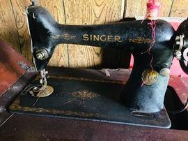 Vintage Singer sewing machine with metal decorative treadle base