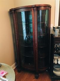 1890's oak clawfoot bow front china cabinet
