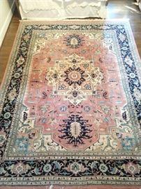 Hand woven Persian Heriz design rug, 100% wool face, measures 9' x 12'.
