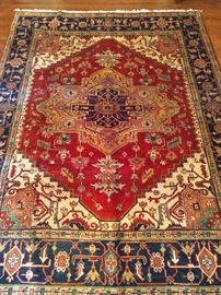Hand Woven Persian Heriz design rug, 100% wool face, measures 8' x 10'.