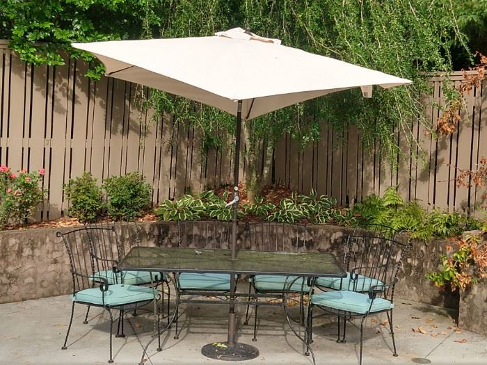 Another very nice vintage wrought iron outdoor furniture set, this one rectangular with six matching armchairs, umbrella and stand.                                       Florence hasn't hit yet, but the umbrella is practicing!