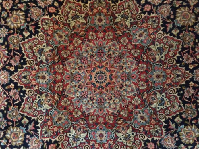 Center medallion of this magnificent Persian rug!