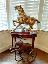 OOOOOOH!!!                                                                                 Scary wild Asian horses and German bear tricycle have joined forces in the dining room to attack anyone who doesn't eat their meat! The hand carved, gilt wood Asian horse is actually quite wonderful - and BIG!