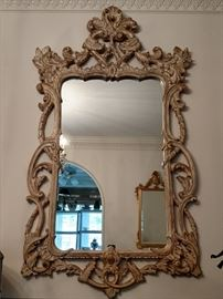 Big ol' swanky mirror in the dining room, above the serpentine mahogany sideboard.