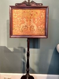 Antique embroidered English mahogany summer fire screen.