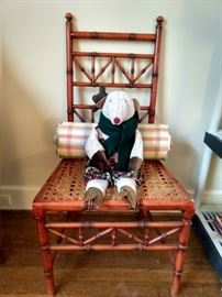 Fun vintage faux bamboo chair, with stuffed reindeer and lumbar pillow for support during that long ride form the North Pole.