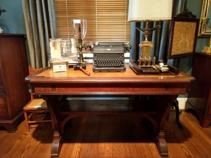 Antique English burled library table, with leather top, stretcher below and side drawer, formerly owned by a prominent female Marietta lawyer, Katherine Hardy. LOVE the vintage Royal typewriter!